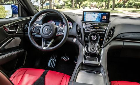 Land vehicle, Vehicle, Car, Motor vehicle, Center console, Vehicle audio, Steering wheel, Personal luxury car, Gear shift,