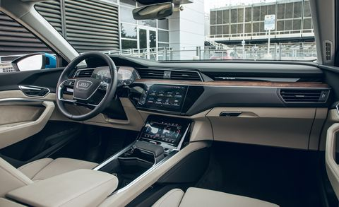 Land vehicle, Vehicle, Car, Motor vehicle, Automotive design, Mid-size car, Center console, Steering wheel, Luxury vehicle, Automotive exterior,