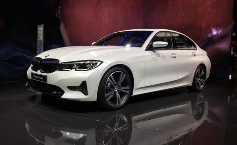Land vehicle, Vehicle, Car, Alloy wheel, Personal luxury car, Automotive design, Bmw 3 series (f30), Luxury vehicle, Wheel, Rim,
