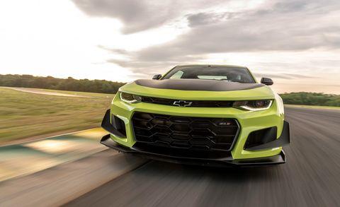 Land vehicle, Vehicle, Car, Chevrolet camaro, Automotive design, Performance car, Bumper, Yellow, Automotive exterior, Mid-size car,