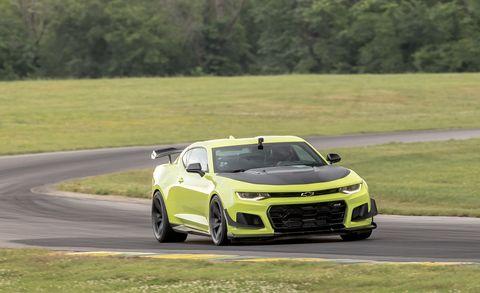 Land vehicle, Vehicle, Car, Automotive design, Performance car, Race track, Yellow, Luxury vehicle, Sports car, Supercar,