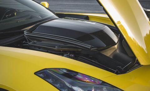 Land vehicle, Vehicle, Car, Hood, Automotive design, Yellow, Windshield, Headlamp, Supercar, Automotive lighting,