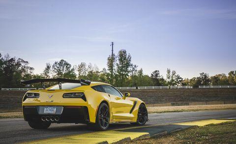 Land vehicle, Vehicle, Car, Sports car, Automotive design, Yellow, Performance car, Corvette stingray, Supercar, Wheel,