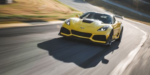 Land vehicle, Vehicle, Sports car, Supercar, Car, Automotive design, Sports car racing, Performance car, Yellow, Race car,