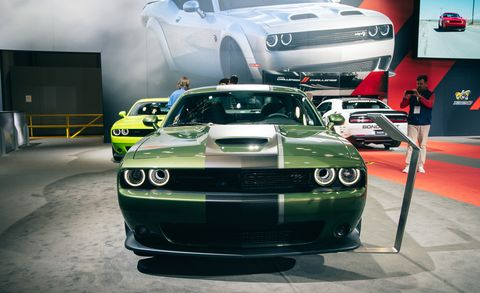 Land vehicle, Vehicle, Car, Muscle car, Auto show, Hood, Sports car, Dodge challenger, Automotive design, Performance car,