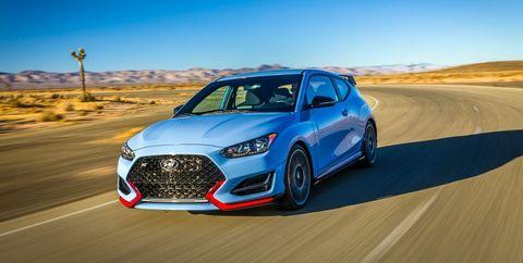Land vehicle, Vehicle, Car, Automotive design, Performance car, Sports car, Mid-size car, Sky, Automotive wheel system, Rim,