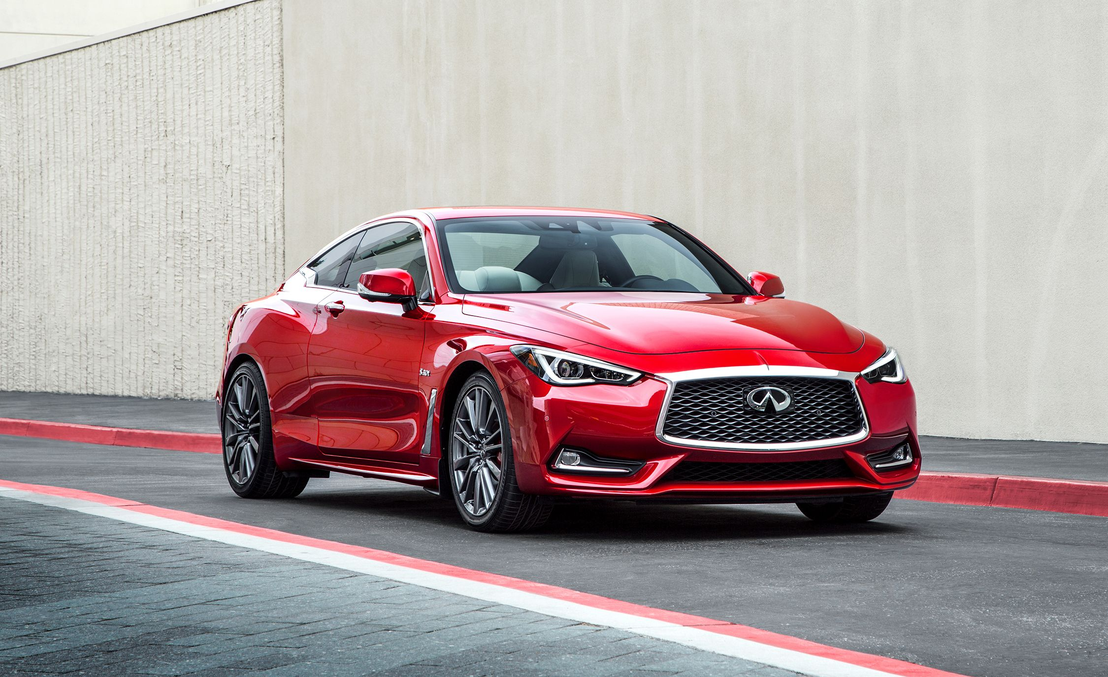 14. Infiniti Q60 Everything said about the four-door Infiniti Q50 applies to the two-door Infiniti Q60 coupe . Also, the Q60 is even better looking—it easily is one of the best-looking cars in the entry-luxe segment, with more rakishness than the Q50 sedan.