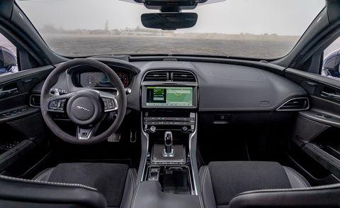 Land vehicle, Vehicle, Car, Motor vehicle, Center console, Luxury vehicle, Steering wheel, Automotive design, Personal luxury car, Performance car,
