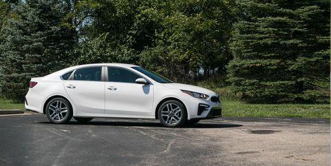 Land vehicle, Vehicle, Car, Mid-size car, Alloy wheel, Rim, Automotive tire, Tire, Automotive design, Wheel,