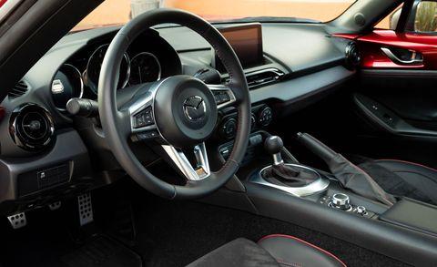 Land vehicle, Vehicle, Car, Steering wheel, Motor vehicle, Center console, Steering part, Speedometer, Personal luxury car, Luxury vehicle,