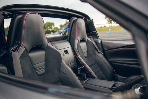 land vehicle, vehicle, car, automotive design, car seat cover, supercar, porsche, family car, steering wheel,