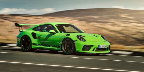 Land vehicle, Vehicle, Car, Automotive design, Sports car, Performance car, Supercar, Yellow, Rolling, Sports car racing,