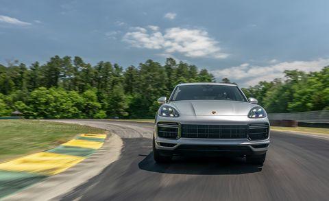 Land vehicle, Vehicle, Car, Automotive design, Luxury vehicle, Performance car, Porsche, Sport utility vehicle, Automotive exterior, Road,
