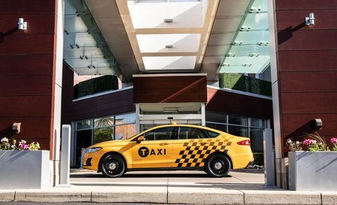Land vehicle, Car, Vehicle, Yellow, Mid-size car, Transport, Taxi, Ford, Architecture, Compact car,