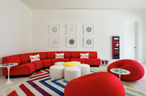 Living room, Furniture, Room, Couch, Interior design, Red, Wall, Table, Floor, Waiting room,