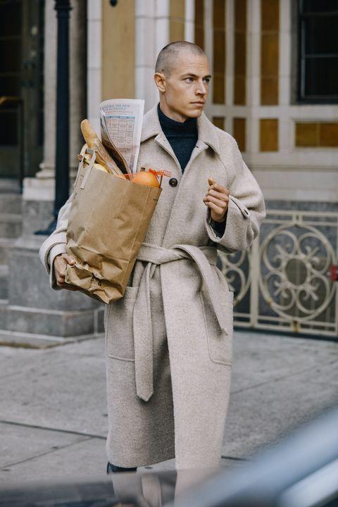 Street fashion, Fashion, Human, Street, Outerwear, Trench coat, Photography, Robe, Sitting, Coat,