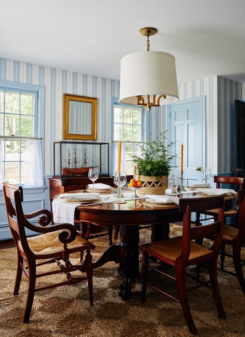 dining room, wooden dining table, wooden dining chairs, blue and white striped wallpaper