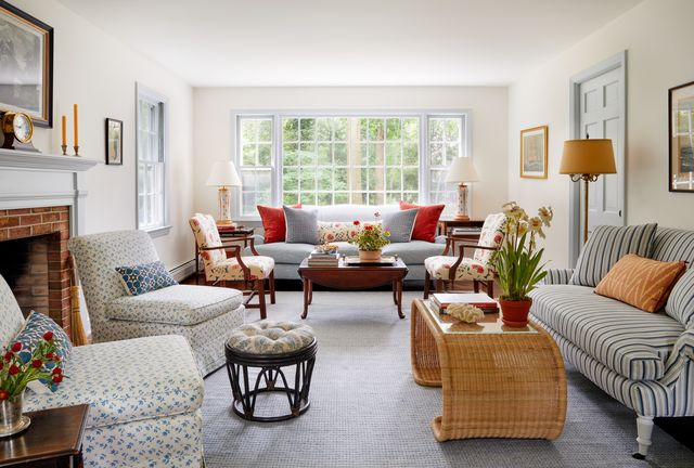 chauncey boothby home tour, living room, blue and white stripped couch, whicker coffee table