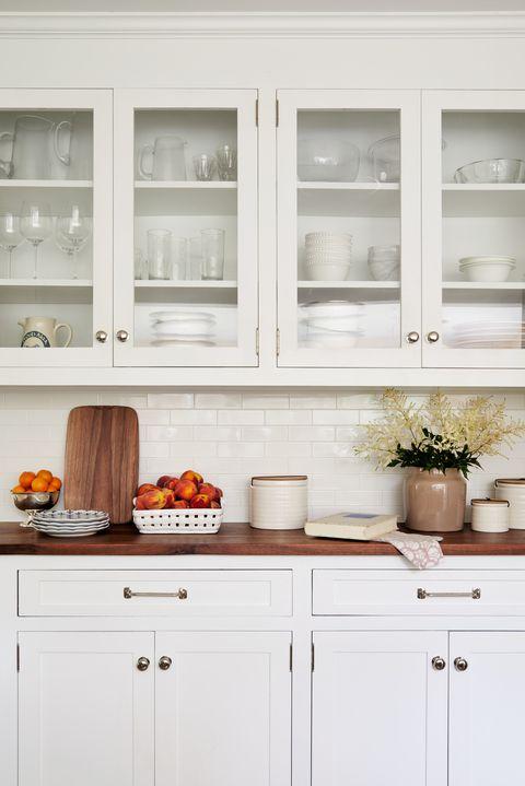 white kitchen cabinets, silver knobs,