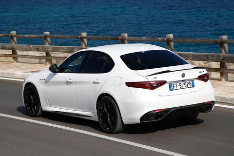 Land vehicle, Vehicle, Car, Luxury vehicle, Automotive design, Mid-size car, Performance car, Full-size car, Alloy wheel, Rim,