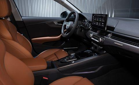 Vehicle, Car, Center console, Motor vehicle, Steering wheel, Audi, Automotive design, Vehicle door, Luxury vehicle, Personal luxury car,