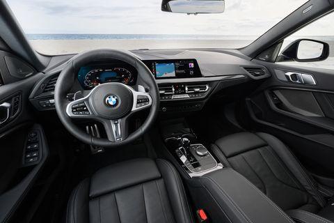 Land vehicle, Vehicle, Car, Personal luxury car, Luxury vehicle, Center console, Motor vehicle, Steering wheel, Bmw, Automotive design,