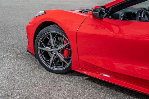 Land vehicle, Vehicle, Car, Red, Alloy wheel, Wheel, Rim, Automotive design, Luxury vehicle, Sports car,