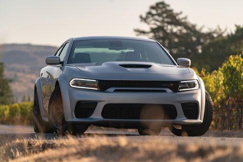 Land vehicle, Vehicle, Car, Automotive design, Performance car, Bumper, Automotive exterior, Rim, Hood, Wheel,