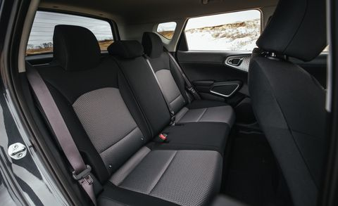 Land vehicle, Vehicle, Car, Car seat cover, Mode of transport, Car seat, Family car, Vehicle door, Seat belt, Plant,