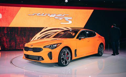 Land vehicle, Vehicle, Car, Automotive design, Auto show, Sports car, Motor vehicle, Coupé, Performance car, Full-size car,