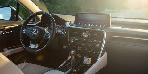 Land vehicle, Vehicle, Car, Steering wheel, Motor vehicle, Luxury vehicle, Center console, Automotive design, Steering part, Lexus,