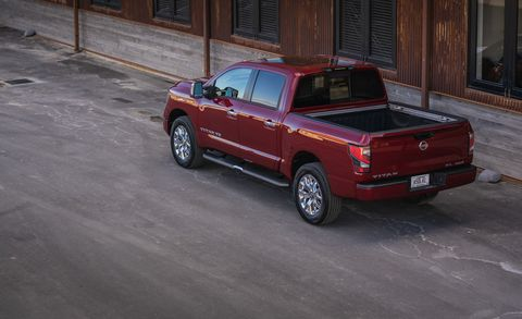Land vehicle, Vehicle, Car, Pickup truck, Motor vehicle, Truck bed part, Automotive tire, Automotive exterior, Tire, Landscape,