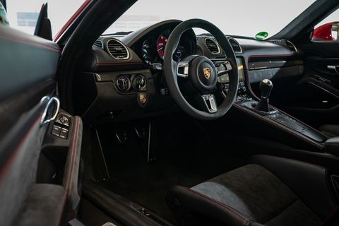 Land vehicle, Vehicle, Car, Steering wheel, Center console, Personal luxury car, Supercar, Luxury vehicle, Automotive design, Porsche,