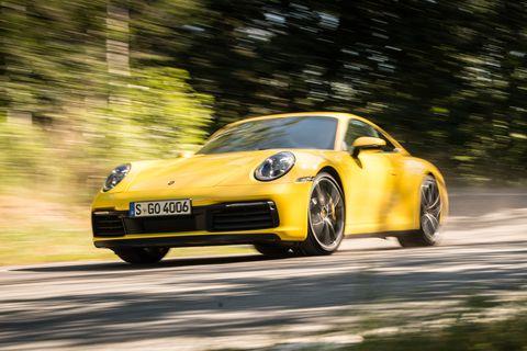 Land vehicle, Vehicle, Car, Yellow, Regularity rally, Automotive design, Supercar, Sports car, Coupé, Performance car,