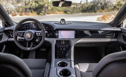 Land vehicle, Vehicle, Car, Steering wheel, Center console, Luxury vehicle, Gear shift, Plant, Porsche, Steering part,