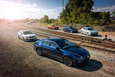 Land vehicle, Vehicle, Car, Automotive design, Luxury vehicle, Sky, Personal luxury car, Mid-size car, Transport, Performance car,