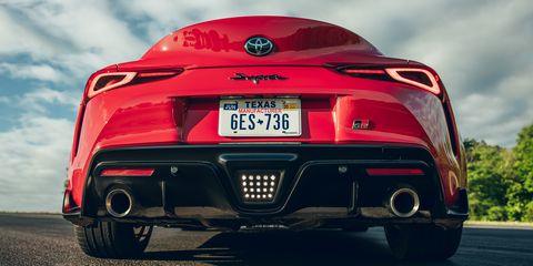 Land vehicle, Vehicle, Car, Automotive design, Red, Performance car, Automotive exterior, Supercar, Automotive lighting, Wheel,