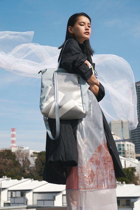 Fashion, Outerwear, Tourism, Leg, Photography, Architecture, Costume, Black hair,
