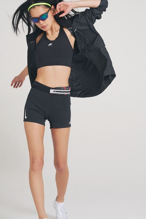 White, Clothing, Shoulder, Fashion, Waist, Joint, Sleeve, Shorts, Outerwear, Leg,