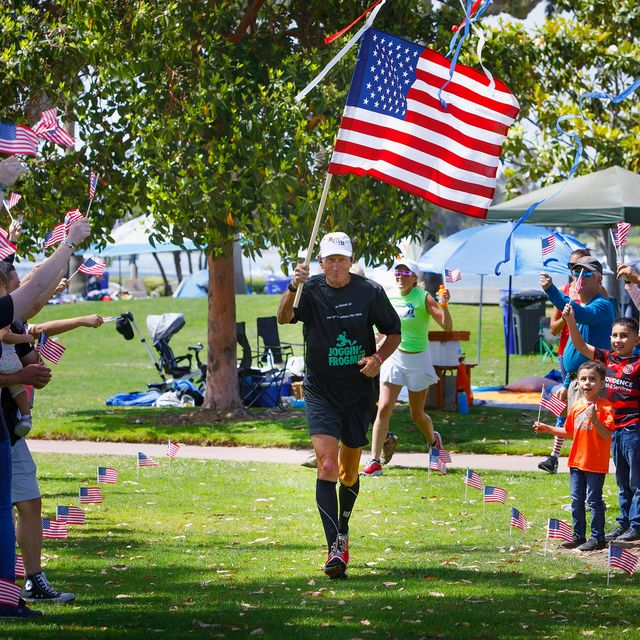 20210531mikerouse31four31four31may 31, 2021, coronado, ca  mike rouse crosses the finish line and becomes emotional after his 31 miles in 31 consecutive days run,  at glorietta park in coronado, to honor the lives of 31 navy seals who were killed in 2011 when the helicopter they were flying in was shot down in afghanistanthe run was to raise money for the boot campaign charity, to help veterans