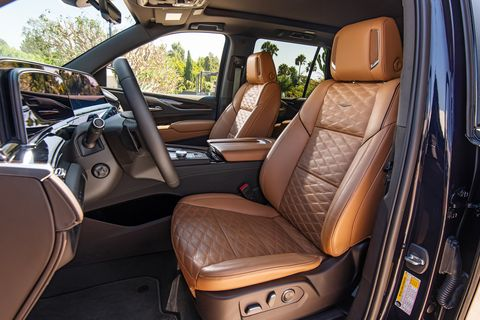 the 2021 cadillac escalade brandy interior with very dark atmosphere accents and full leather seats with faceted quilting
