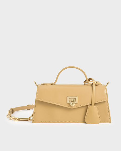奶黃梯形吊飾手提包