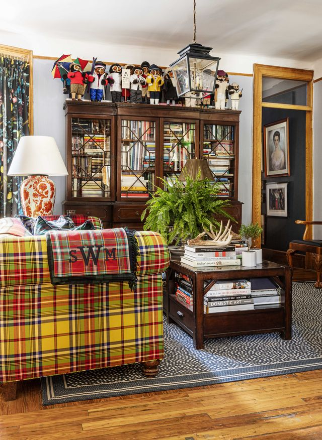 living room, tartan couch, wooden coffee table, area rug, indoor plants, bookcase