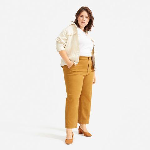 Clothing, Khaki, Waist, Beige, Standing, Tan, Yellow, Neck, Trousers, Sleeve,