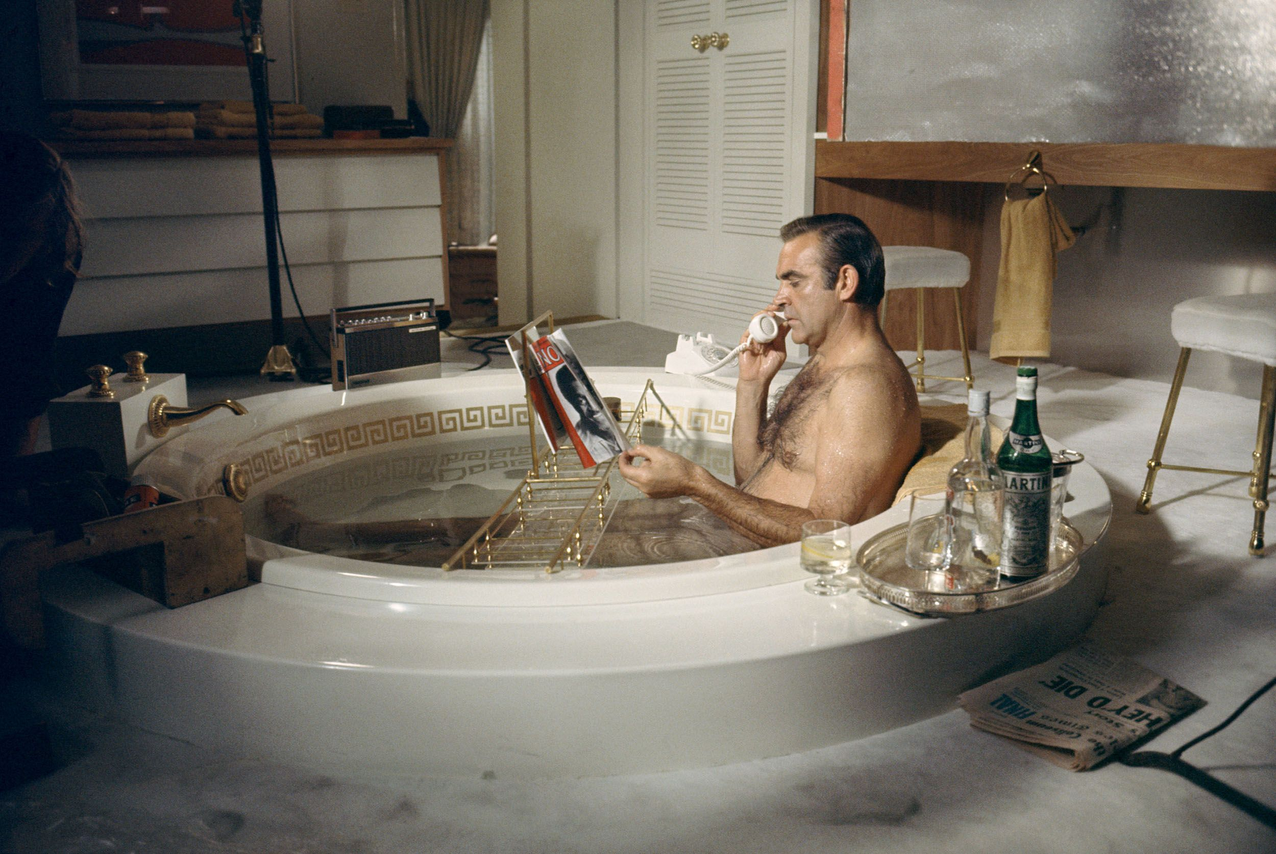 Sean Connery takes a relaxing bath with a vodka martini on the set of Diamonds Are Forever.