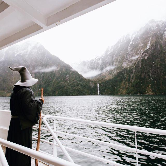 Sky, Mountainous landforms, Mountain, Water, Fjord, Atmospheric phenomenon, Wilderness, Sound, Lake, Tourism,