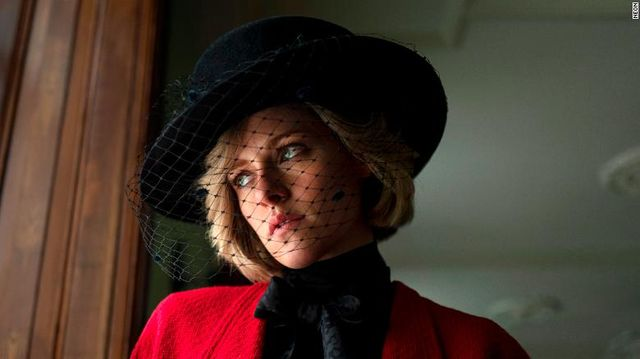 kristen stewart as princess diana in the upcoming film spencer wearing a red coat and black fascinator hat first look