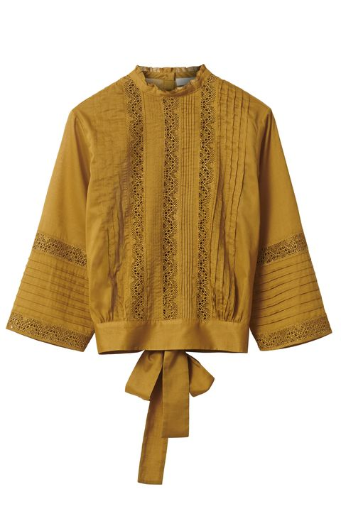 Clothing, Outerwear, Yellow, Sleeve, Brown, Blouse, Beige, Neck, Costume, Poncho,