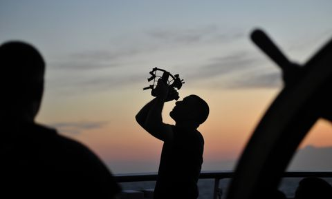 senior chief petty officer mike rosati uses a sextant while conducting celestial navigation training while sailing on the atlantic ocean aboard the coast guard cutter eagle, aug 3, 2015 celestial navigation is taught to the coast guard academy cadets while they spend time underway on the eagle us coast guard photo by petty officer 2nd class matthew s masaschi
