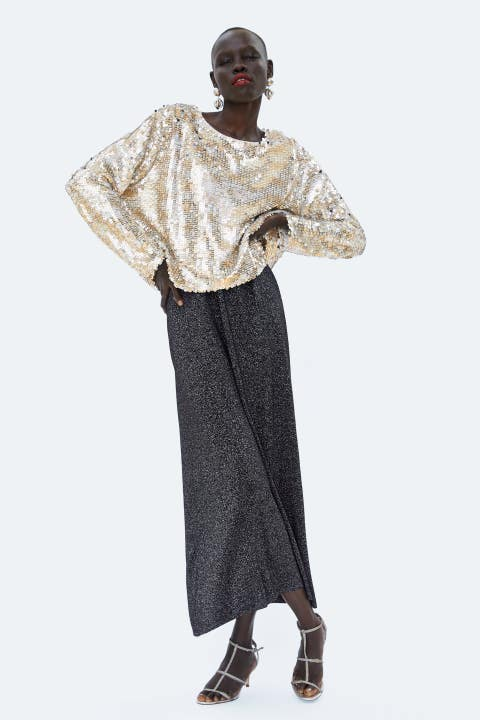 Clothing, Standing, Fashion, Sleeve, Costume, Dress, Trousers, Beige, Outerwear, Fashion design,